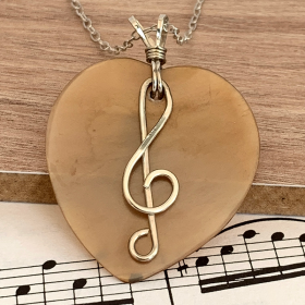 Treble Clef Heart Pendant made from Sterling Silver
