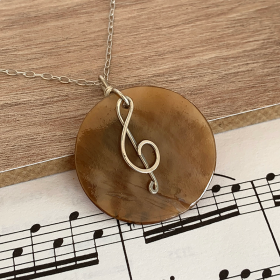 Treble Clef Circle Pendant made from Sterling Silver